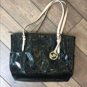 Michael Kors Bags - Authentic MK purse. Black and Tan.
